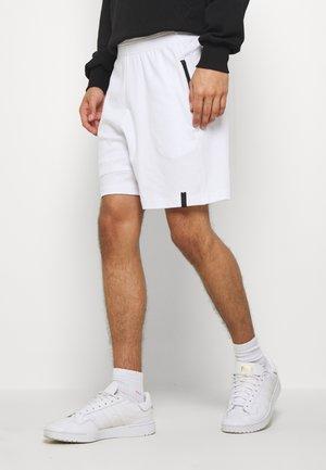 Verryttelyhousut - white