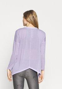 Puma - STUDIO GRAPHENE LONG SLEEVE - Langarmshirt - light lavender - 2