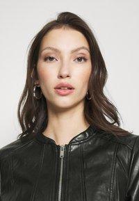 Vero Moda - VMBUTTERALBA COATED JACKET - Faux leather jacket - black - 3