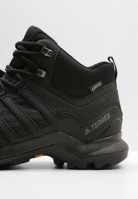 adidas Performance - TERREX SWIFT R2 MID GTX GORETEX HIKING SHOES - Hiking shoes - core black - 5