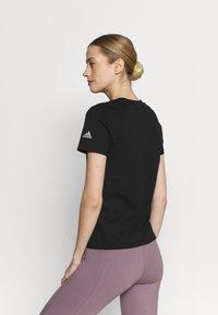 adidas Performance - T-shirts med print - black/white - 2