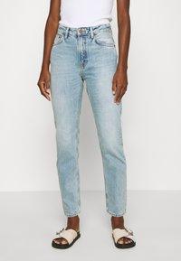 Nudie Jeans - BREEZY BRITT - Relaxed fit jeans - light desert - 0
