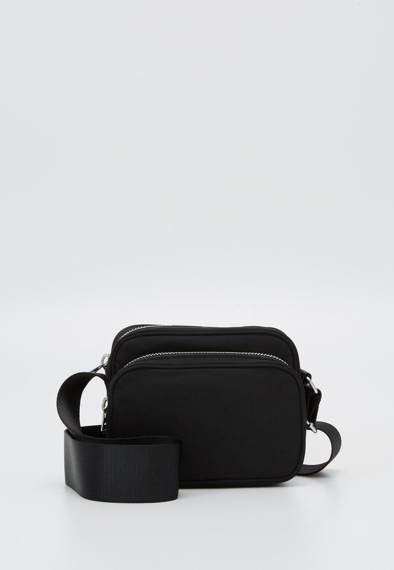 Weekday - SUND CROSSBODY BAG - Across body bag - black