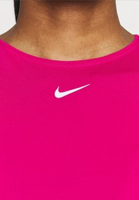 Nike Performance - ALL OVER - Camiseta básica - fireberry/white - 4