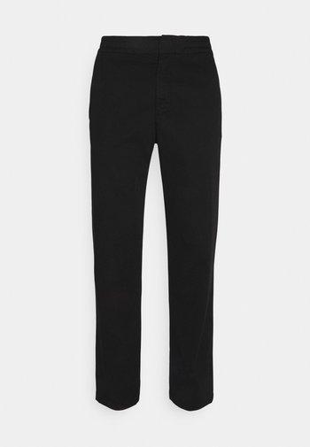 FOSS - Trousers - black