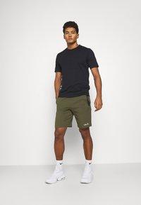 Calvin Klein Performance - SHORT SLEEVE - T-shirt con stampa - black - 1