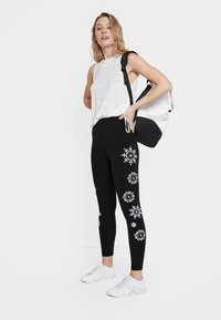 Desigual - MANDALA SWISS EMBRO - Leggings - Trousers - black - 1