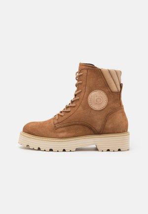 CAROLINA - Lace-up ankle boots - cognac/beige