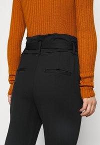 ONLY Petite - ONLPOPTRASH LIFE YO EASY - Trousers - black - 6