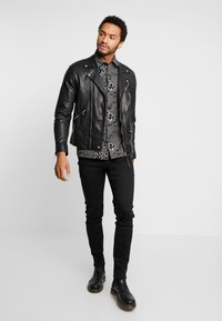 Replay - ANBASS - Slim fit jeans - black - 1
