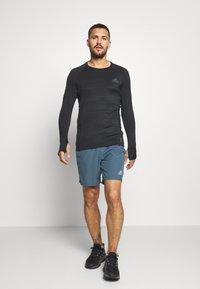 adidas Performance - OWN THE RUN - Pantalón corto de deporte - blue - 1