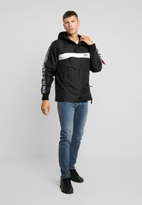 Alpha Industries - AL TAPE ANORAK - Light jacket - black - 1