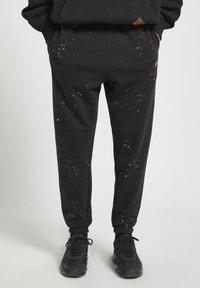 PULL&BEAR - Pantaloni sportivi - mottled black - 0