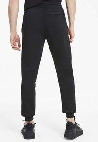 Puma - Pantalon de survêtement - cotton black - 2
