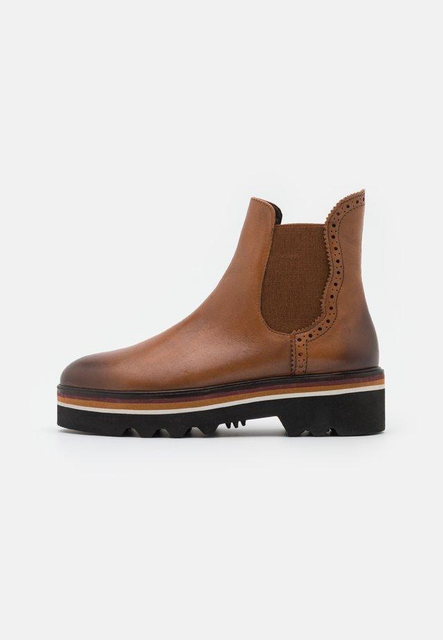CELIN - Platform ankle boots - cognac