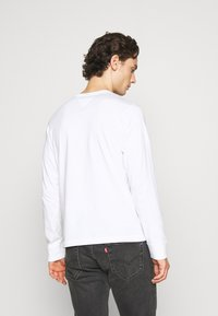 Tommy Jeans - LONGSLEEVE LOGO UNISEX - Long sleeved top - white - 2