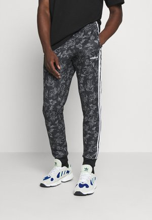 GOOFY - Jogginghose - black/white