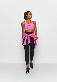 Nike Performance - IMPACT STRAPPY BRA - Sujetadores deportivos con sujeción alta - pink glow/black - 1