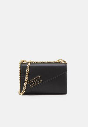 ASYMMETRIC SMALL SHOULDER BAG - Across body bag - nero