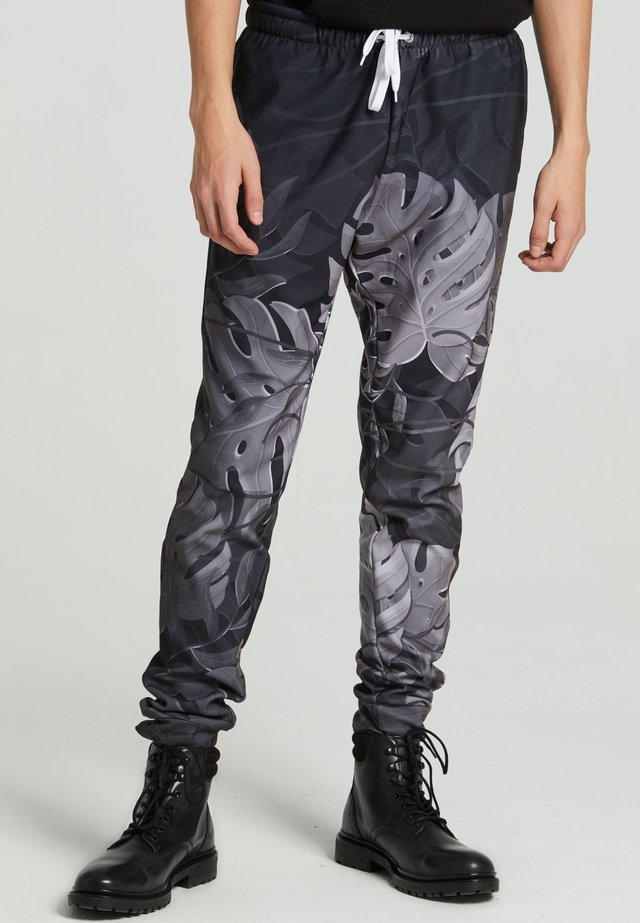 MONSTERA - Pantaloni sportivi - black
