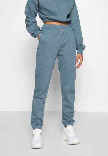 COZY PANTS - Pantalones deportivos - blue