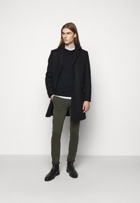 Tiger of Sweden - TRANSIT - Trousers - black green - 1