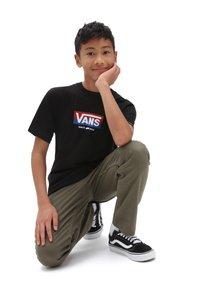 Vans - Print T-shirt - black - 1