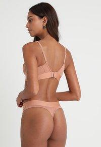 Calvin Klein Underwear - LINED BRALETTE - Kaarituettomat rintaliivit - beige - 2