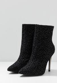 Tamaris - High heeled ankle boots - black - 4