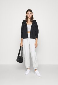 Nike Sportswear - Tracksuit bottoms - light bone - 1