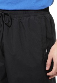Vans - MN DIMENSION TRACK PANT - Tracksuit bottoms - black - 1
