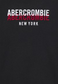 Abercrombie & Fitch - REPEATED TECH LOGO - Long sleeved top - black