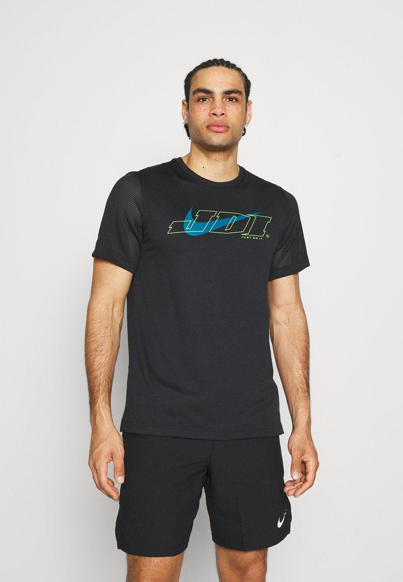Nike Performance - T-shirt print - black/green abyss