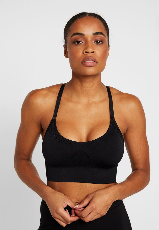 THE COMFORT STRAPPY - Light support sports bra - black
