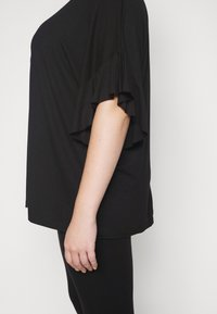 CAPSULE by Simply Be - BOXY RUFFLE SLEEVE  - Basic T-shirt - black - 5