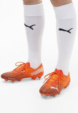 Screw-in stud football boots - shocking orange-puma black