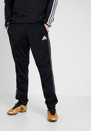 CORE HERREN - Tracksuit bottoms - black