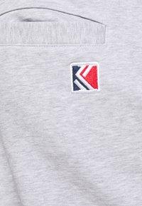Karl Kani - SIGNATURE  - Tracksuit bottoms - ash grey - 4