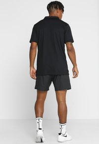 Nike Performance - DRY TEAM - Camiseta de deporte - black - 2