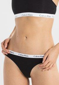 Calvin Klein Underwear - THONG 3 PACK - Tanga - black - 1