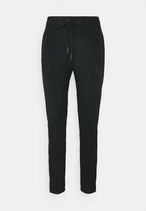 PANT TAPERED HORSESHOE - Tracksuit bottoms - black