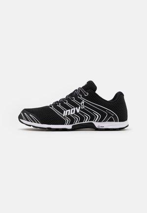 F-LITE G 230 - Sports shoes - black/white