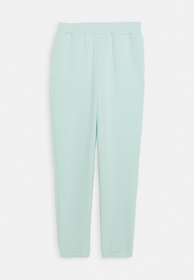 LILIAN - Tracksuit bottoms - pastel mint