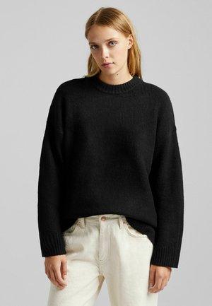 OVERSIZED - Stickad tröja - black