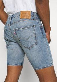 Levi's® - 412™ SLIM - Denim shorts - light-blue denim - 4
