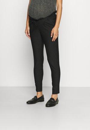 OLMPOPTRASH CLASSIC PINSTRIPE FRILL - Trousers - black