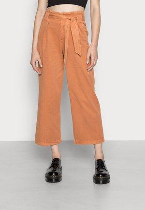 POSITIVITY VIBES - Trousers - sunburn