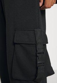 Missguided - SEAT BELT TROUSER - Verryttelyhousut - black - 5
