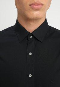 Calvin Klein Tailored - EXTRA SLIM - Formal shirt - black - 3