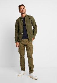Dstrezzed - COMBAT PANTS  - Pantaloni cargo - army green - 1